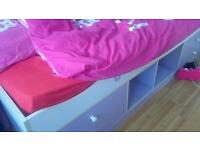 Girls bedroom wardrobe and bed