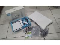 Wii and Wii Fit Board with one game