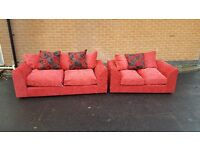 Superb Brand New red pink fabric sofa suite. 3 and 2 seater sofas, never used,can deliver