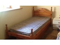 Single pine bed with storage drawer for sale - very good condition. £25