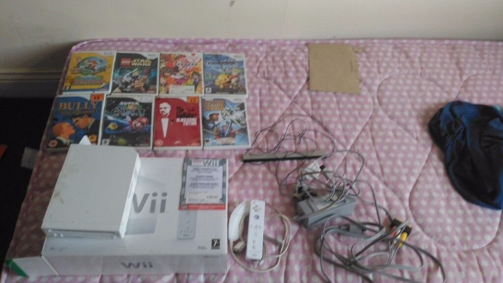 Nintendo Wii boxed with 8 games