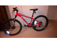 Mens red specialized hardrock mountain bike / bicycle with tools, helmet and rucksack