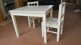Child's wooden table and two chairs