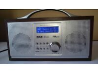 Sainsbury's RED Wooden Classic DAB / FM Digital Portable Radio in very good working condition.