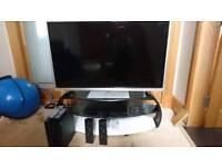 Panasonic TV with stand, surround sound, 3d glasses and dvd player