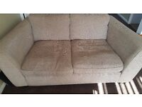 2x used beige 2 seater sofas and large footstool