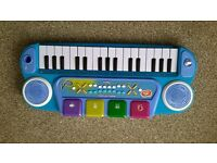 childs keyboard, mic and seat