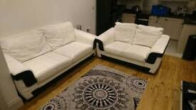 Triple and double white leather sofas
