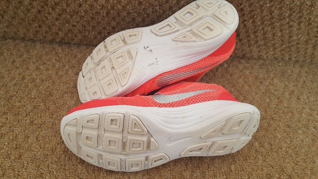 90c7d82ebc uk size 1 nike trainers bright pink orange with velcro strap