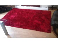 Heavy good quality long pile rug, red also 3 red cushions