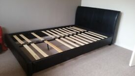 Dark synthetic leather bed frame and mattress