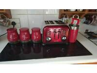 Red kitchen set including toaster