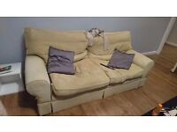 Two sofas, beige/yellow, comfy.