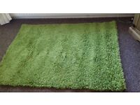 Rug green in colour good clean condition.
