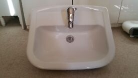 High quality white ceramic semi-recessed basin complete with Hansgrohe tap
