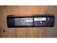Black Xbox 360 E 500 GB with controller, 16 games, headset and HDMI cable.