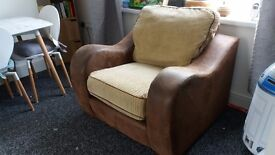 Large cream cord and brown leather arm chair