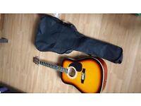 A Chantry six string acoustic guitar, model 3369, sunburst body