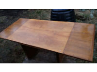 Unusual extending dining table - needs a sand/varnish - Very sturdy - Offers