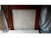 Wood Fire surround, marble backing with Hearth.