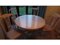 Dining table and 4 upholstered chairs. Excellent condition, scratch/stain free 105cm
