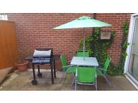 Garden table and BBQ grill