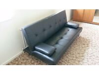 Black faux leather click-clack sofa bed for sale