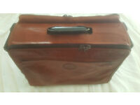 High quality brown leather overnight/weekend saddlebag style case.