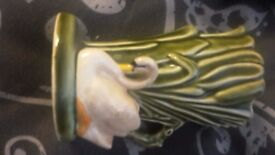 Sylvac vase , green with white swan on front .