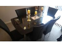 Stunning Black Glass Dinning Table and 6 Chairs (Black), bought from Harveys