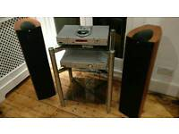 Rega Jupiter CD player, Rega Mira amplifier, 2x KEF Q5 Series Speakers, Apollo stand