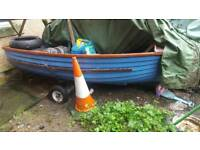 Boat, engine, trailer, 5 life jackets and oars