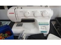 Janome sewing machine and threads