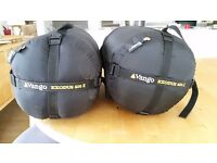 Two sleeping bags that zip together