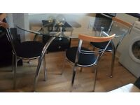 Glass and chrome with 4 chairs