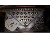 BRAND NEW Alice silver eyelet clutch bag