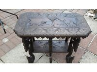 Small wooden table carved with lion and elephant