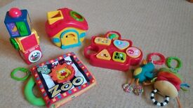 Bundle of baby toys - 2 shape sorters, 2 pram toys, stacking activity cubes, sensory cloth book