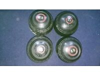 Set of four bowling balls.
