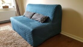 Great condition Ikea Lyckesele 2 seat sofa bed with top of line mattress (Havet) + colourful cover