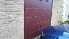 15 month old manual garage door. Rosewood colour in very good condition.