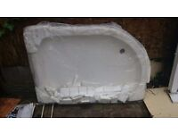 white ceramic shower tray