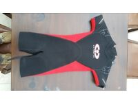 Kids shortie wetsuit, black with red sides. Suit 9-10 years