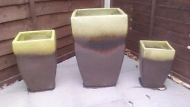 Set of 3 large glazed plant pots.