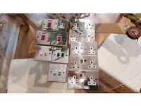 Various used stainless steel sockets and switches