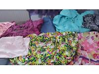 A bundle of girl's clothes for 10yrs old in an excellent condition like brand new
