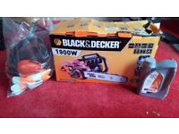 Black and Decker (new and never used) corded chainsaw with helmet/visor, earmuffs, gloves and oil