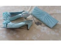 Mint colour matching shoes and bag