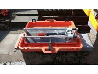 Tile cutters. Both in excellent condition and very hi spec.