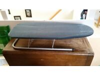 Free half size ironing board. Perfect for storing and fine for shirt ironing